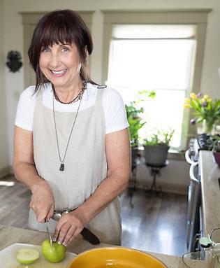 Jill Seebantz, Radical Wellness Coach, demonstrates in her kitchen.